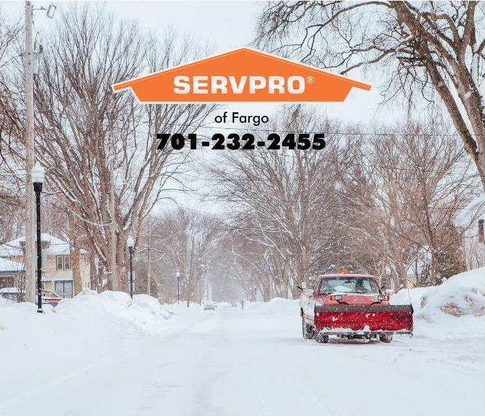 A street in Fargo, ND., is covered with snow.
