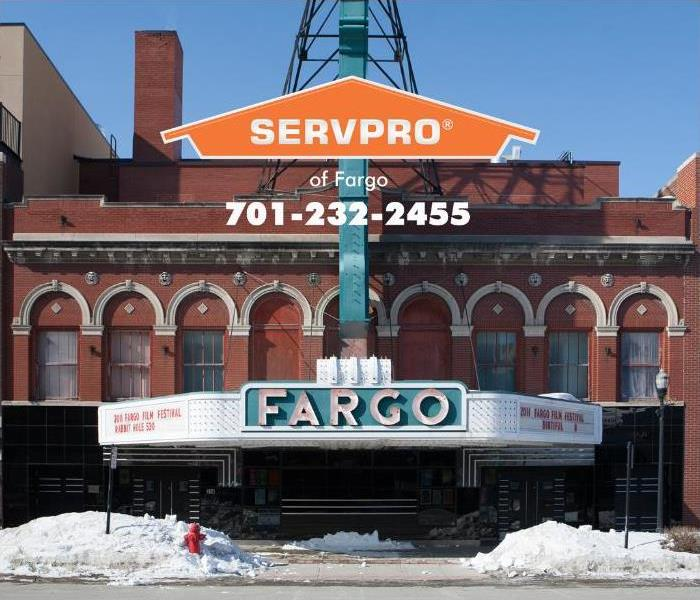Snow is piled up on the street outside of the Fargo Theatre.